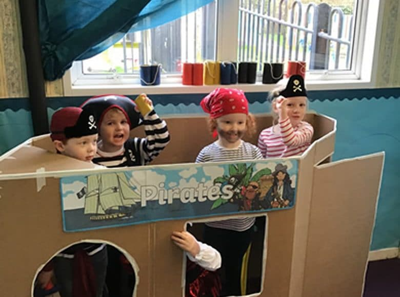 The children in their pirate boat