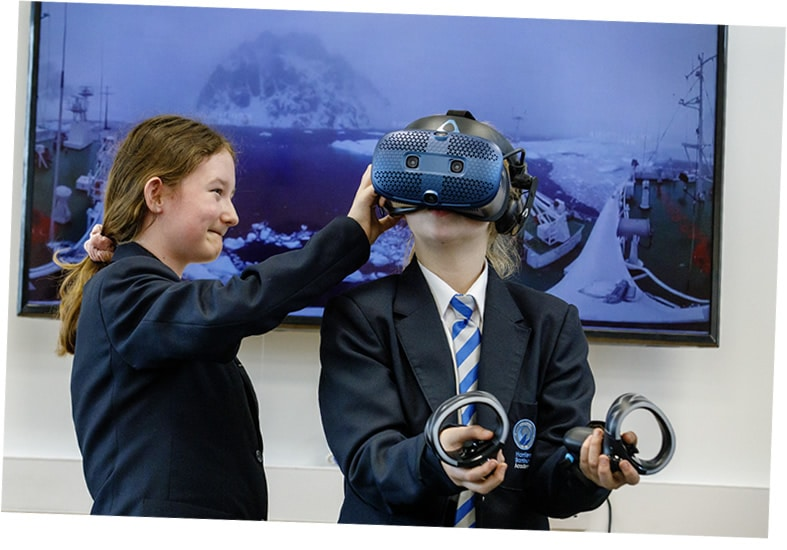 Girls using VR in a lesson