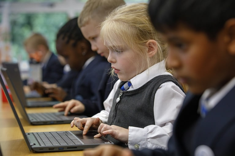 KS1 pupils using laptops